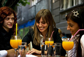 Young women drinking orange juice