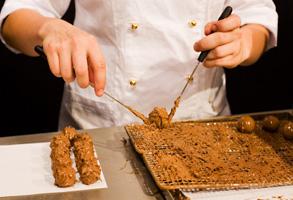 Chef making chocolate truffles
