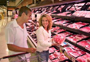 Couple shopping for meat in a supermarket