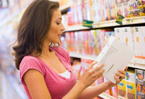 Woman at supermarket - nutrition label